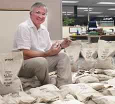 [photo: Littleton Coin's president David Sundman among bags of Ikes from the Big Sky Hoard]