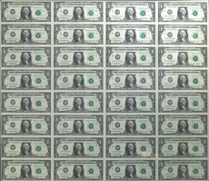 [photo: An uncut sheet of 32 $1 bills]
