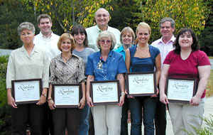 Coin Company Honors Seven for Quality Achievement