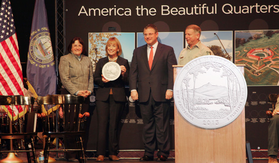 New Hampshire Governor Maggie Hassan gives away National Park quarters at the U.S. Mint's official White Mountain National Forest Quarter release ceremony