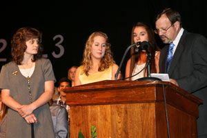 Littleton Coin's Stan Fillion presents scholarships at LHS Class Night. (Photo courtesy of Al Perry)