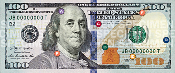 [photo: Security features on a Series 2009 $100 Federal Reserve Note]