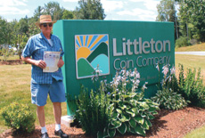 [photo: Visitor with Showcase at Littleton Coin Company]